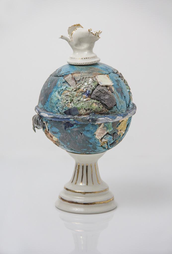 ceramic sculpture in shape of perfume bottle
