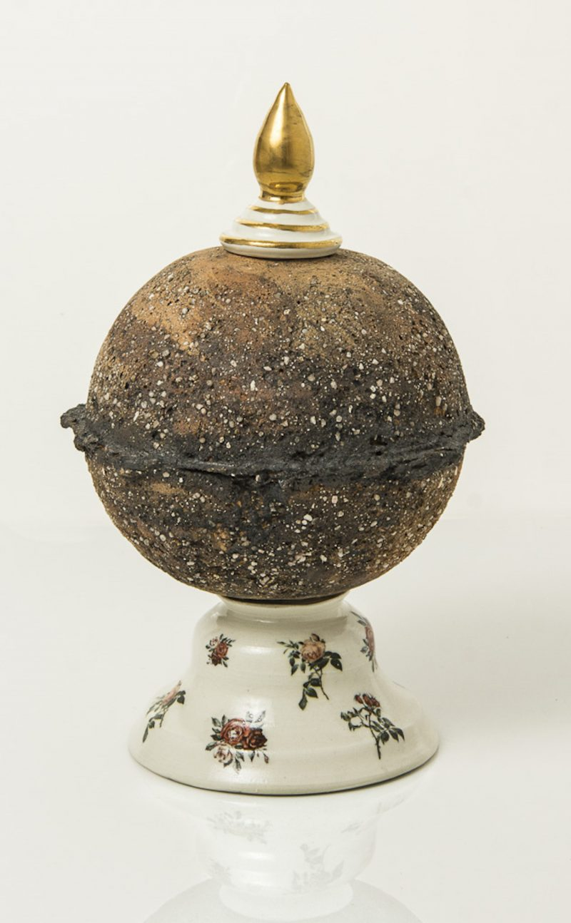 ceramic globe sculpture with bottle stopper