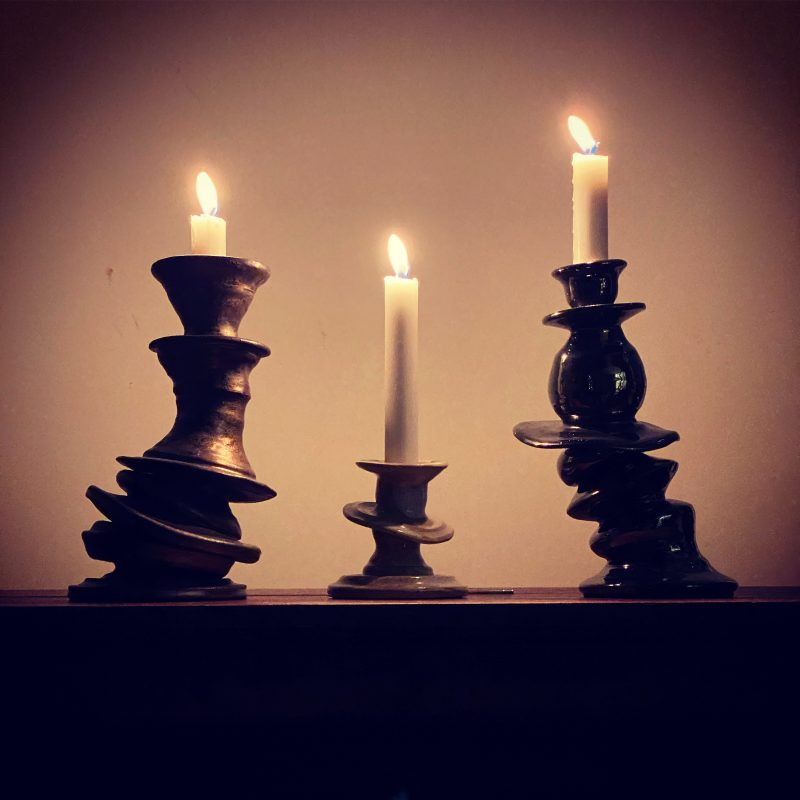 three funky candleholders